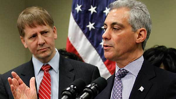 Mayor Rahm Emanuel announces new reforms to protect Chicago families from financial fraud as Consumer Financial Protection Bureau (CFPB) Director Richard Cordray looks on at the Department of Business Affairs and Consumer Protection Hearing Room located inside of City Hall in Chicago Dec. 5, 2012.
