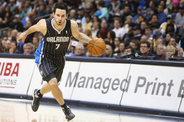 Orlando Magic guard J.J. Redick (7) drives to the basket during the first half against the Denver Nuggets at the Pepsi Center.