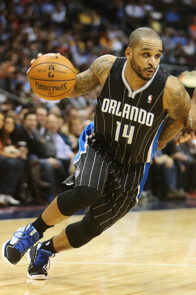Orlando Magic guard Jameer Nelson (14) drives to the basket during the first half against the Denver Nuggets at the Pepsi Center.