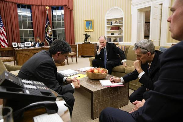 Chief of Staff Jacob Lew, national security advisor Thomas Donilon and deputy national security advisor Denis McDonough, left to right in the foreground, listen on Nov. 14 to President Obama on a conference call. As white males, the aides are representative of his new appointees.