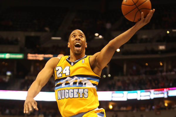 Denver Nuggets guard Andre Miller (24) drives to the basket during the second half against the Orlando Magic at the Pepsi Center. The Nuggets won 108-105.
