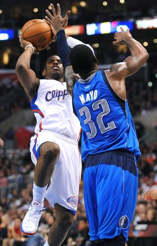 Clippers point guard Chris Paul pulls up for a jumper over Mavericks guard O.J. Mayo on Wednesday night.