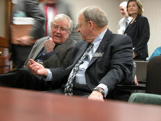 Former state Sen. Henry Carlson Jr., R-Sioux Falls, right, chatted with Rep. Hal Wick, R-Sioux Falls, after Carlson's testimony Wednesday to the Senate Taxation Committee. Carlson successfully fought for a clean-up of South Dakota's contractor excise tax in 1983-84 and he urged legislators Wednesday to keep the tax in place.
