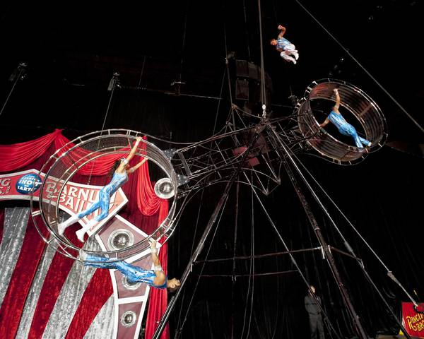 The Flying Cruzados rotate the 46-foot Double Wheel of Steel to speeds of more than 15 mph by walking inside and outside of the wheel.