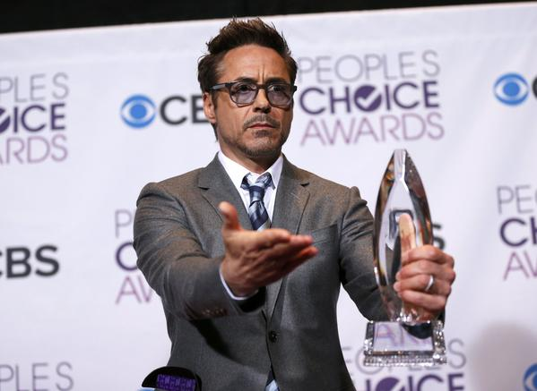 Robert Downey Jr. holds his award for favorite movie actor backstage at the 2013 People's Choice Awards in Los Angeles, January 9, 2013.