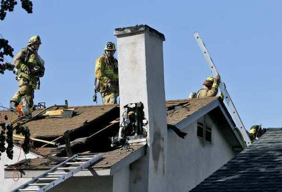 Burbank Firefighters put out a fire on the 500 block of Stanford in Burbank on Tuesday, January 8, 2013.