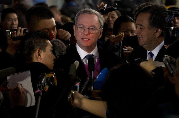 Google Executive Chairman Eric Schmidt, center, and former New Mexico governor Bill Richardson brief journalists after they arrived at Beijing Capital International Airport from North Korea on Thursday.
