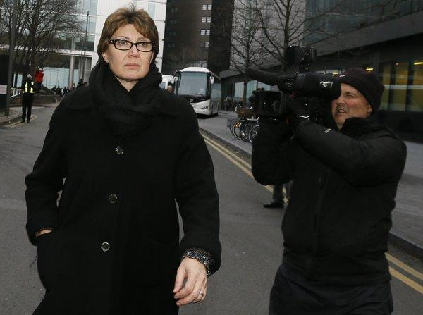 April Casburn, a senior counterterrorism detective with Scotland Yard, was found guilty Thursday of trying to sell confidential information to a British tabloid. Casburn is the first police officer to be convicted in a corruption probe spawned by Britain's phone-hacking scandal.