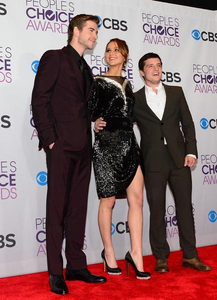"From left, Liam Hemsworth, Jennifer Lawrence and Josh Hutcherson of ""The Hunger Games."" Lawrence wore a Valentino Couture dress with Nicholas Kirkwood heels, Cartier jewelry and Valentino Couture bag."