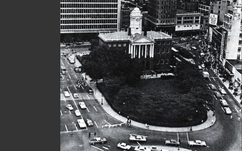 Aerial view of State House Square in the 1970s with State Street (at right) open.