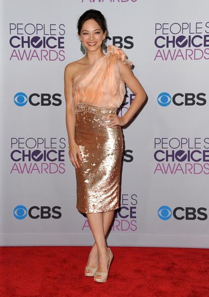 Kristin Kreuk in a one-shoulder dress with sequin skirt.