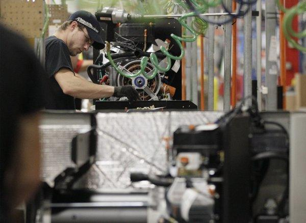 An employee works on an assembly line at Generac Power Systems Inc. in Whitewater, Wis.