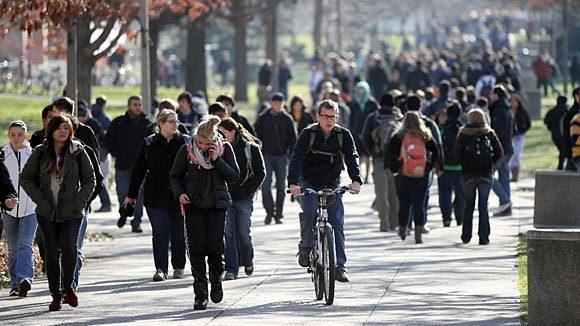 Students walk through the Quad at the University of Illinois at Urbana-Champaign in November.
