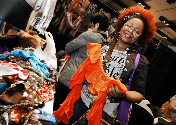 Jacinta Lewis checks out an orange scarf, this year's Pantone color, at the My Time Women's Show, held Saturday, January 28, 2012 at the Hampton Convention Center.