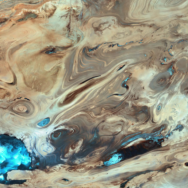 The Dasht-e Kevir, or Great Salt Desert, is the largest desert in Iran. It is primarily uninhabited wasteland, composed of mud and salt marshes covered with crusts of salt that protect the meager moisture from completely evaporating.  This image was acquired by Landsat 7's Enhanced Thematic Mapper plus (ETM+) sensor on October 24, 2000. This is a false-color composite image made using infrared, green, and red wavelengths. The image has also been sharpened using the sensor's panchromatic band.