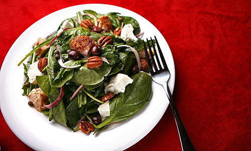 Pecans and goat cheese add texture and flavor to chicken, spinach, arugula and dandelion greens.