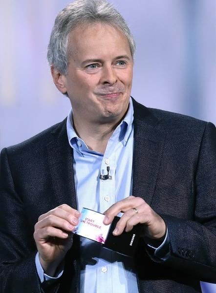 Brian Berkeley, senior vice president of Samsung's display lab, shows a prototype of the Youm flexible display at CES.