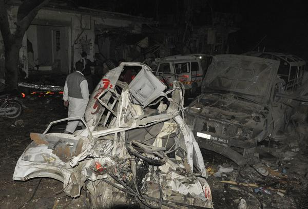 Destroyed vehicles remain at the site of a bomb attack in the Pakistani city of Quetta.