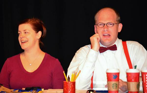 "From left, Leesa Hanna, playing the host of the spelling bee, and Jeff Lindberg, playing the word pronouncer, in the Moonlight Players production of ""The 25th Annual Putnam County Spelling Bee."""