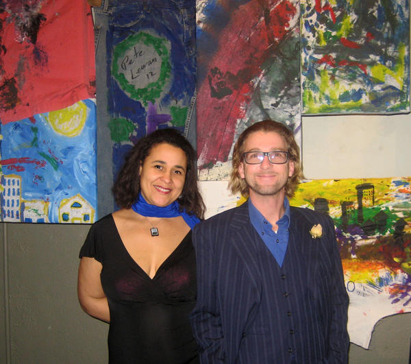 "Artists Katie Heffelfinger and Anthony Donnelly stand in front of ""Fabric of the Community,"" a 15-panel art installation created as a fundraiser for the Allentown 250th Anniversary New Year's Eve party at Allentown Brew Works."