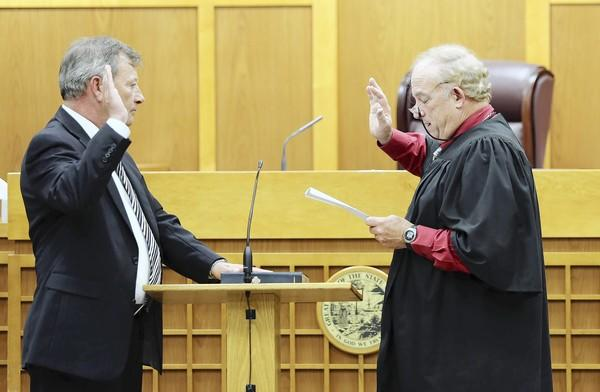 Mike Graves, left, is formally sworn in as Public Defender for the 5th Judicial Circuit by Judge T. Michael Johnson on Tuesday, January 8, 2013. Graves won the August election to replace Skip Babb, who retired after 8 terms in office. (Tom Benitez/Orlando Sentinel)
