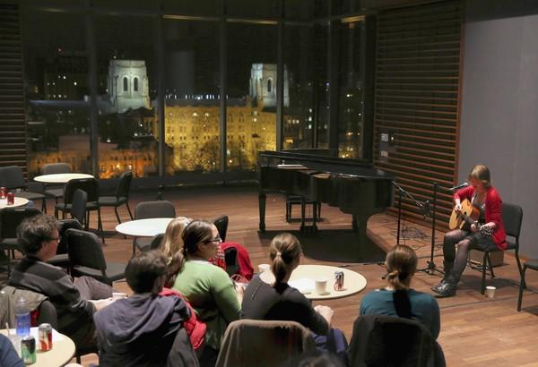 University of Chicago student Izzy Olive sings and plays guitar in the Performance Penthouse at the Logan Center for the Arts on the campus of the University of Chicago.