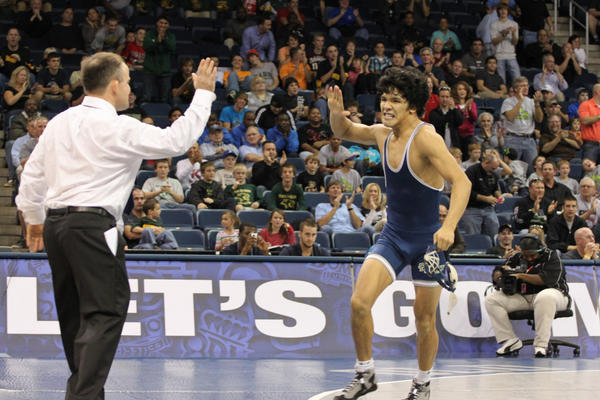 Old Dominion 133-pound wrestler Scott Festejo celebrates after a match with coach Steve Martin.