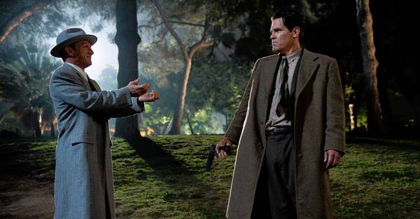 "Sean Penn, left, stars as gangster Mickey Cohen, with Josh Brolin as LAPD Sgt. John O'Mara in ""Gangster Squad."""