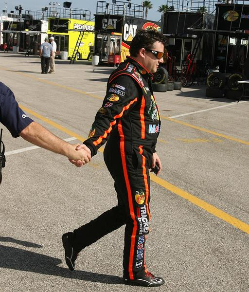 Tony Stewart walks through the garage area during NASCAR Sprint Cup Series Preseason Thunder at Daytona International Speedway in Daytona Beach, FL, on Thursday, January 10, 2013.