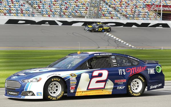 Brad Keselowski (2) waits on pit road for his turn as the race car of Ricky Stenhouse, Jr. (17) passes by the start finish line during testing during NASCAR Sprint Cup Series Preseason Thunder at Daytona International Speedway in Daytona Beach, FL, on Thursday, January 10, 2013.
