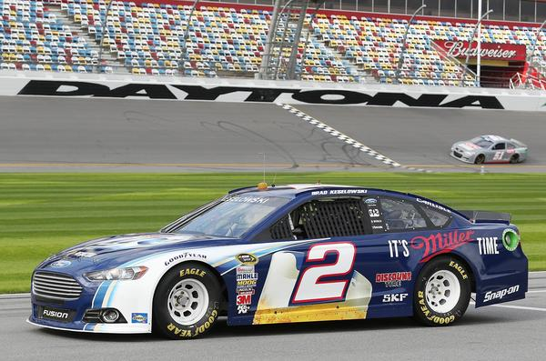 Brad Keselowski (2) waits on pit road as Regan Smith (51) crosses the start/finish line during testing during NASCAR Sprint Cup Series Preseason Thunder at Daytona International Speedway in Daytona Beach, FL, on Thursday, January 10, 2013.
