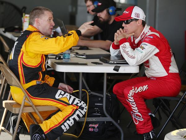 Jeff Burton, left, and Kevin Harvick chat in the garage during NASCAR Sprint Cup Series Preseason Thunder at Daytona International Speedway in Daytona Beach, FL, on Thursday, January 10, 2013.