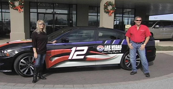 Rich and Paula Robertson are pictured with one of their winning prizes - a Dodge Charger worth $60,000.