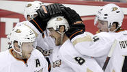 As the clock ticks hurriedly to NHL's opening night Jan. 19, the Ducks gathered Thursday at Honda Center for an informal practice without a coach partially to gauge where their conditioning is before the 48-game sprint of a labor-stoppage-shortened season.