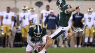 Michigan State fifth-year senior kicker Dan Conroy closed his college football career the same way he did his high school career — with a piece of paper.