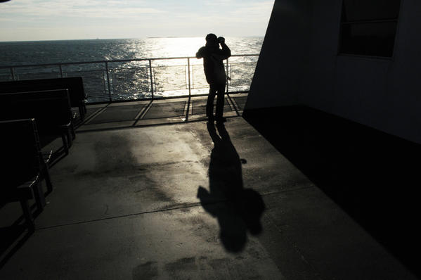 Long Island Sound is a study in contrasts Jan. 5 as Clare Meade of Wethersfield looks for birds aboard the John H. Ferry in Long Island Sound.