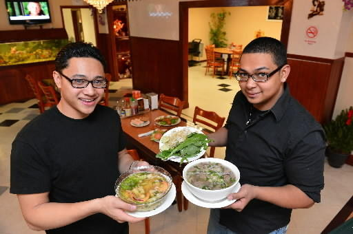 Manager Richon Tran (left) holds Hu Tien/ Mi Do Bien and manager Richard Tran holds Pho Dac Biet at Hai Ky Pho Ga Vietnamese Cuisine in Whitehall.