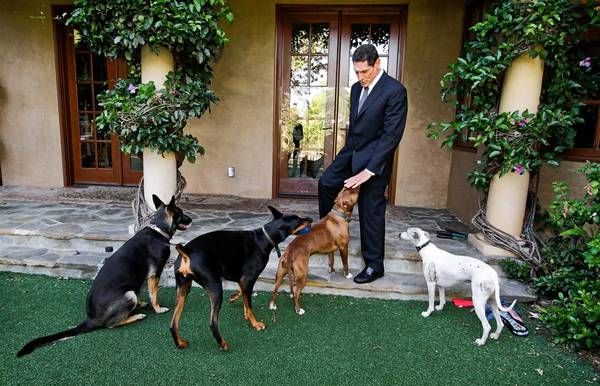 Dr. Gary Michelson at home in Los Angeles with his dogs. As a medical student, Michelson objected to learning surgery by operating on live dogs. Today, he is the sponsor of the Michelson Prize in Reproductive Biology, which offers $25 million for the first researcher to create an easy, affordable means of sterilizing animals.