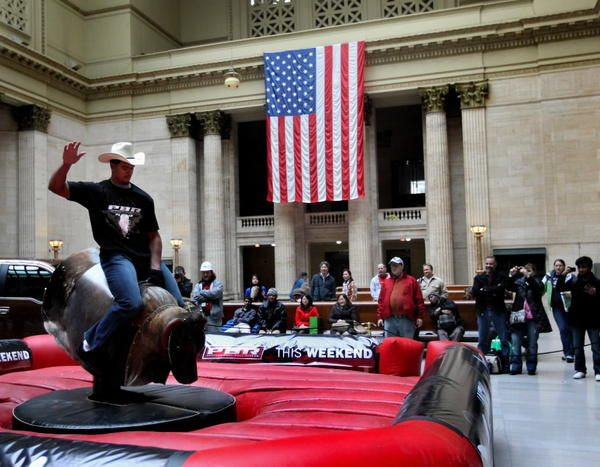 Bears defensive lineman Corey Wootton rides a mechanical bull at Union Station in Chicago in 2011.