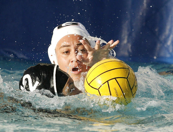 Glendale's Maddie Corpuz reaches to the ball in front of the Hoover goal against Hoover's Maggie Amirian in the second quarter in a Pacific League girls water polo match at Hoover High School in Glendale on Thursday, January 10, 2013.