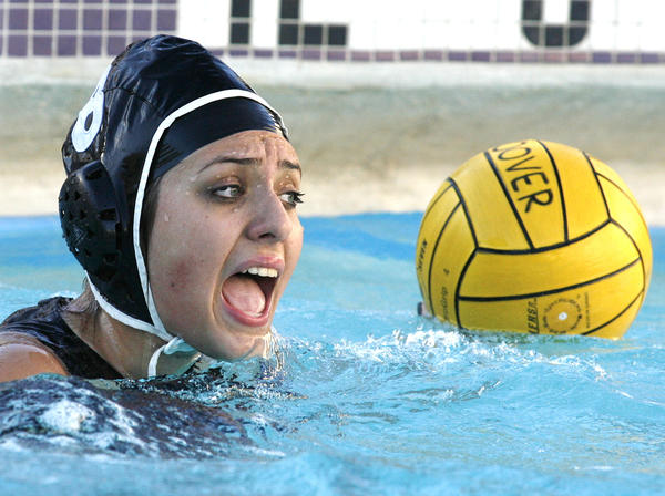 Hoover's Shushan Makaelyan yells to her team to move and get open as she is pinned in a corner by Glendale in the second quarter in a Pacific League girls water polo match at Hoover High School in Glendale on Thursday, January 10, 2013.
