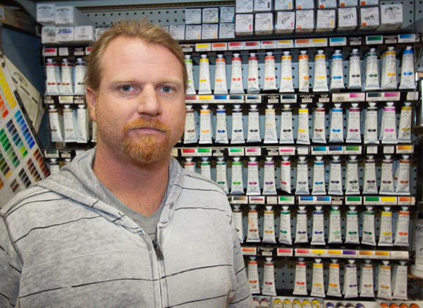 Noel Lashely, manager at Laguna Art Supply, offers art supplies in a range of prices.