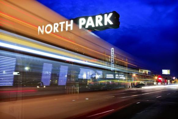 Cars and buses streak along University Avenue in San Diego's  North Park area, one of America's hippest hipster neighborhoods, according to Forbes.