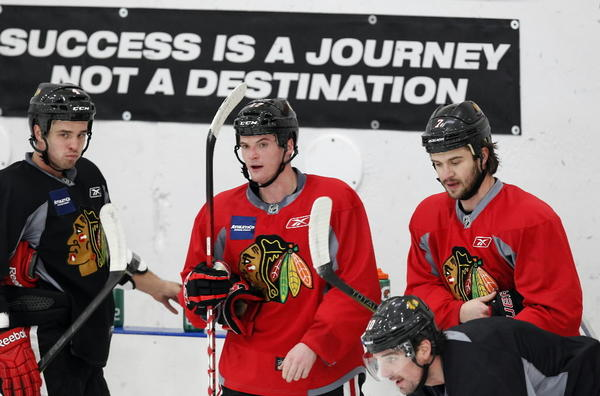 The Blackhawks' Niklas Hjalmarsson (from left), Sheldon Brookbank (17) and Brent Seabrook take a breather during practice Wednesday.