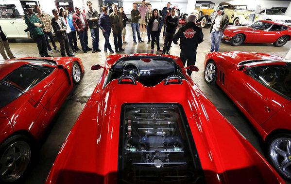 Tour guide Kevin Blackley talks about a trio of Ferraris to visitors touring the Petersen Automotive Museum vault.