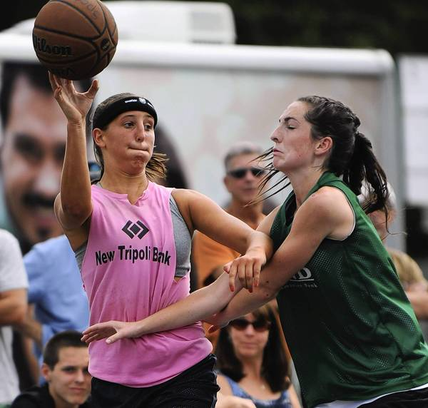 Northwestern's Sara Jones passes the ball over an Emmaus player at SportsFest on July 21, 2012.