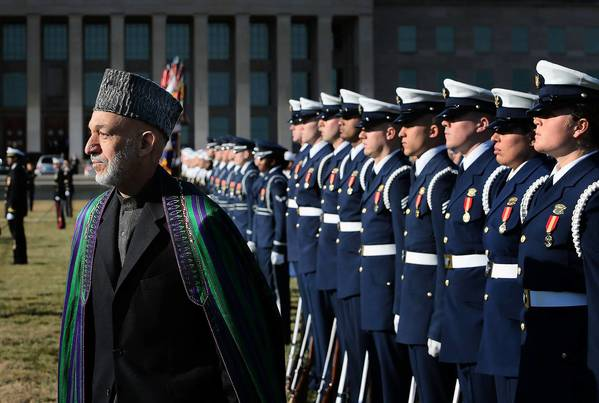 Afghan President Hamid Karzai reviews an honor guard during a ceremony welcoming him to the Pentagon in Washington.