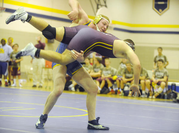 Perry Hall's Matt Green takes down Hereford's Matt Swiger in a battle of unbeatens, won by the Gator 220-pound defending state champion.