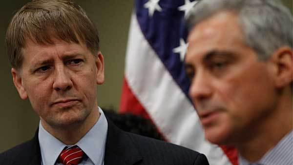 Mayor Rahm Emanuel announces new reforms to protect Chicago families from financial fraud as Consumer Financial Protection Bureau (CFPB) Director Richard Cordray looks on at the Department of Business Affairs and Consumer Protection Hearing Room located inside of City Hall in Chicago on Wednesday, Dec. 5, 2012.