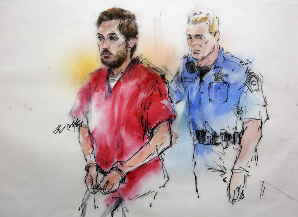 This courtroom sketch shows James Holmes being escorted by a deputy as he arrives at preliminary hearing in district court in Centennial, Colo., on Monday. Investigators say Holmes opened fire during the midnight showing of the latest Batman movie on July 20, killing 12 people and wounding dozens.